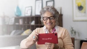 Woman enjoying her Grandpad tablet