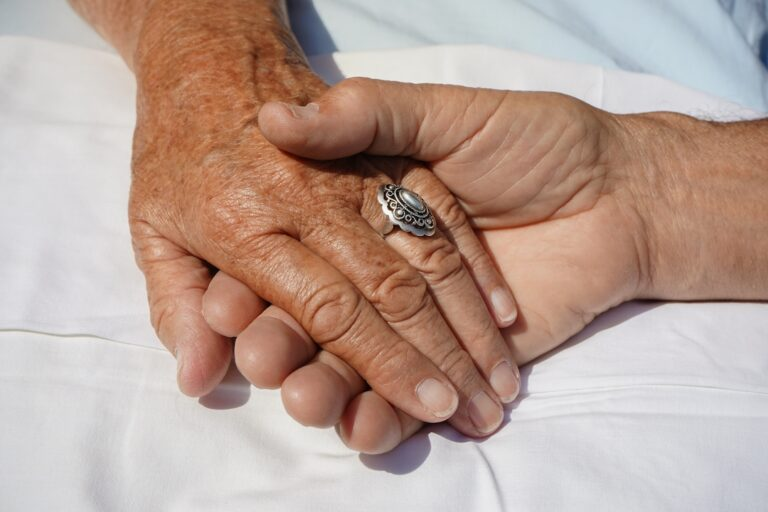 Close-up of two individuals holding hands